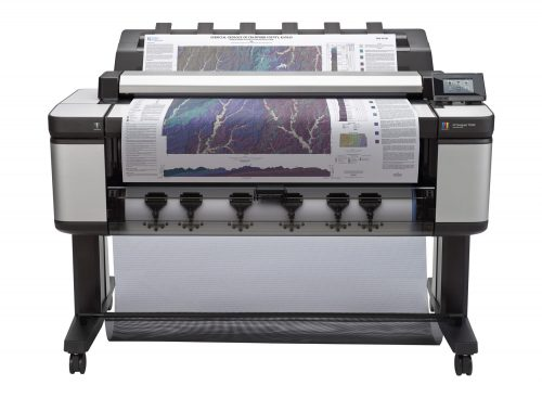 An image of a large format printer in use that has been repaired by Paw Print Copiers