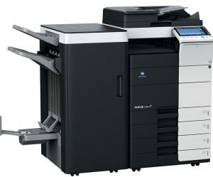 An image of a large, freestanding Konica photocopier.